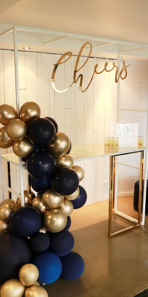 navy gold placesetting showroom L